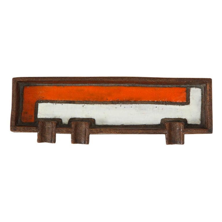 Raymor Bitossi Ashtray, Mondrian Orange, Brown and White, Signed. Long ashtray with 3 cigarette or cigar rests. Decorated with a Mondrian pattern of white and orange glazes over coarse matte brown. Signed with an impressed mark: Italy to the