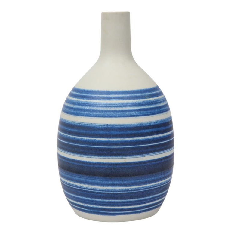 Raymor vase ceramic, blue and white stripes, signed. Small scale gourd vase with a Scandinavian feel, decorated navy blue stripes over a bisque white body. Signed with Raymor paper label on the underside.