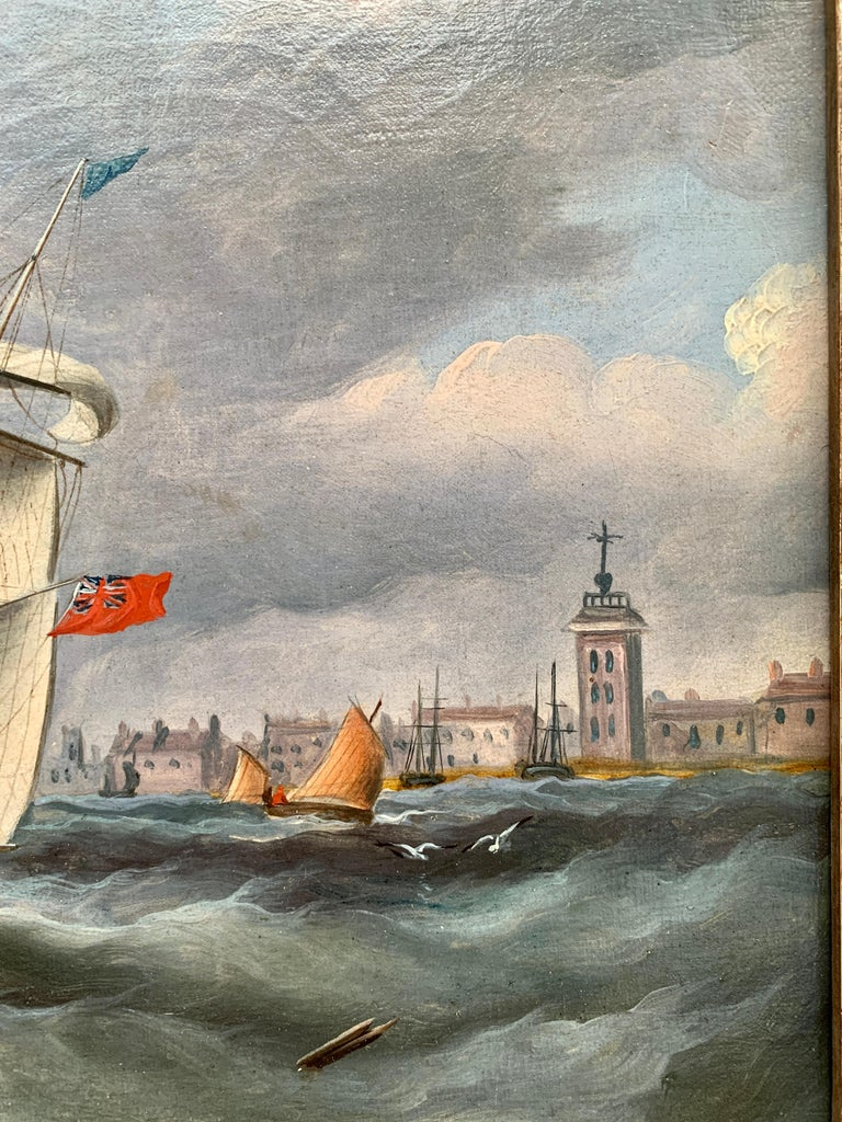 Antique English marine View of pff the English coast, with yachts and a warship sailing just outside a  harbor.  R. B. Spencer is known for his portraits of ships. It is thought that he is the brother of William Barnett Spencer who painted the same