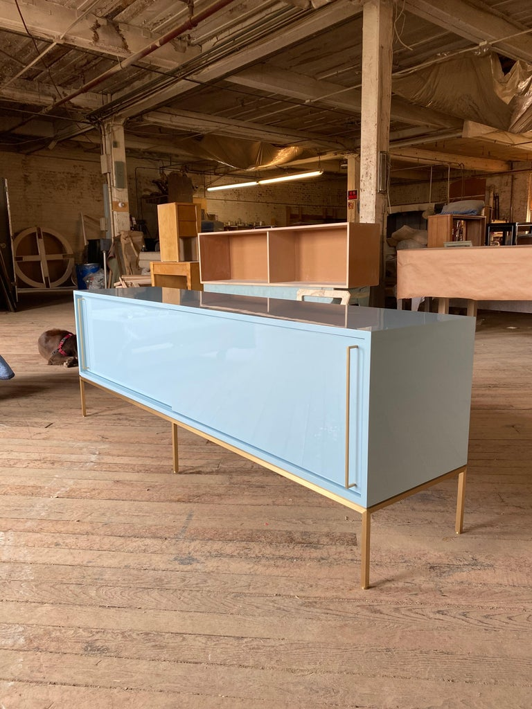 American re: 379 Lacquered Credenza on Solid Brass Base For Sale