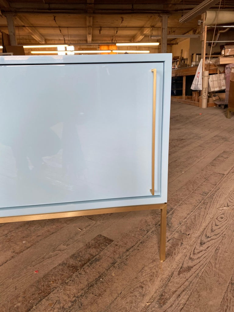 Contemporary re: 379 Lacquered Credenza on Solid Brass Base For Sale