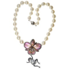 Real Orchid, Frog, Dragonfly in Diamond and Sapphire on Australian Pearl Collar