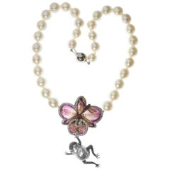 Real Orchid, Frog, Dragonfly in Diamond & Sapphire on an Australian Pearl Collar