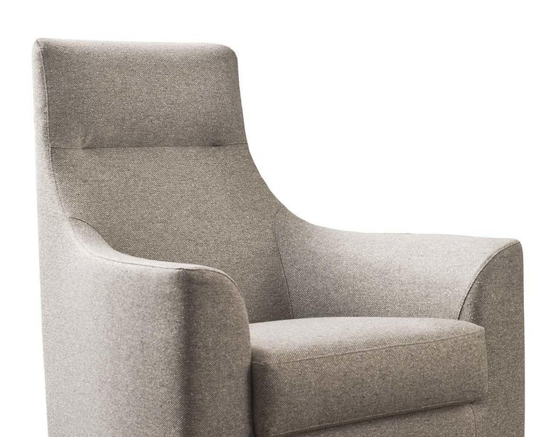 Showcased in a traditional-style living room or private study, this striking armchair will be an elegant and comfortable addition with its high back and enveloping armrests. The rounded shape offers an inviting embrace within a softly padded yet