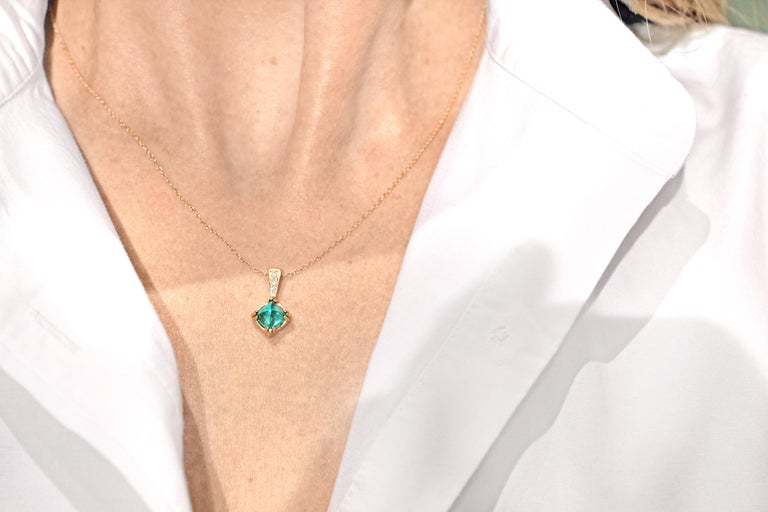 One-of-a-Kind Vintage Emerald Necklace handcrafted in matte-finished 14k yellow gold showcasing a spectacular bluish-green completely natural and unheated 1.37 carat vintage sugarloaf emerald accented with a 0.025 total carats of round brilliant-cut