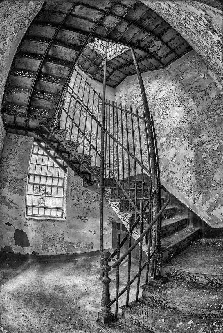 "Rebecca Skinner Black and White Photograph - ""Stairway"", photograph, black and white, abandoned, iron, steel, fisheye"