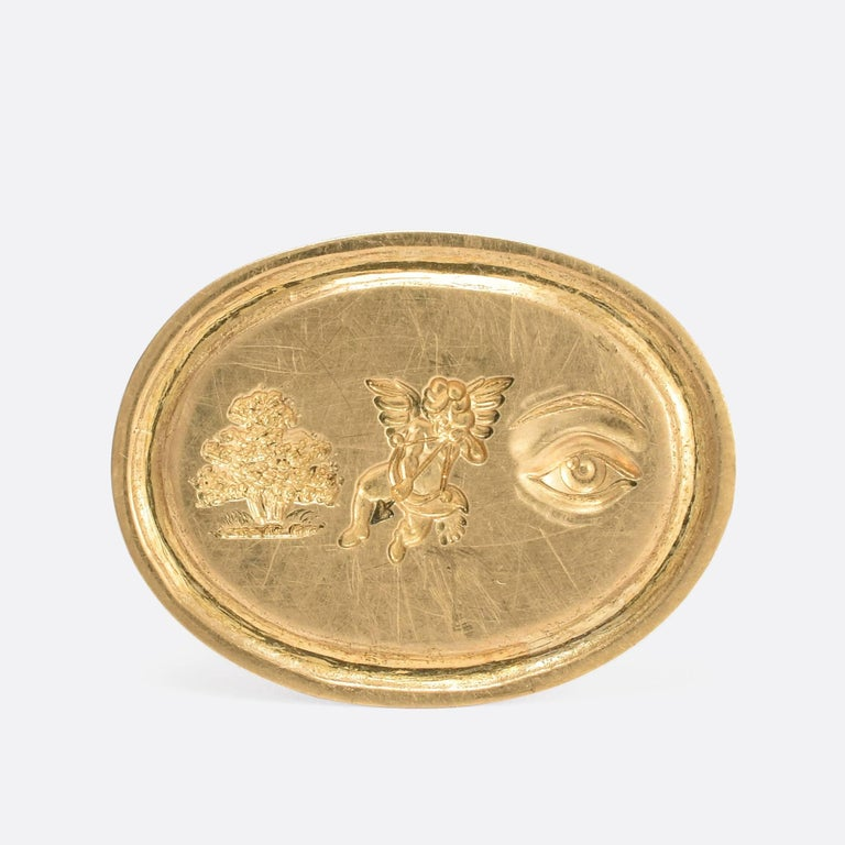 This gold signet ring features a hand carved intaglio rebus puzzle. Popular in the Georgian era, the rebus puzzle typically uses pictures, symbols or letters to phonetically