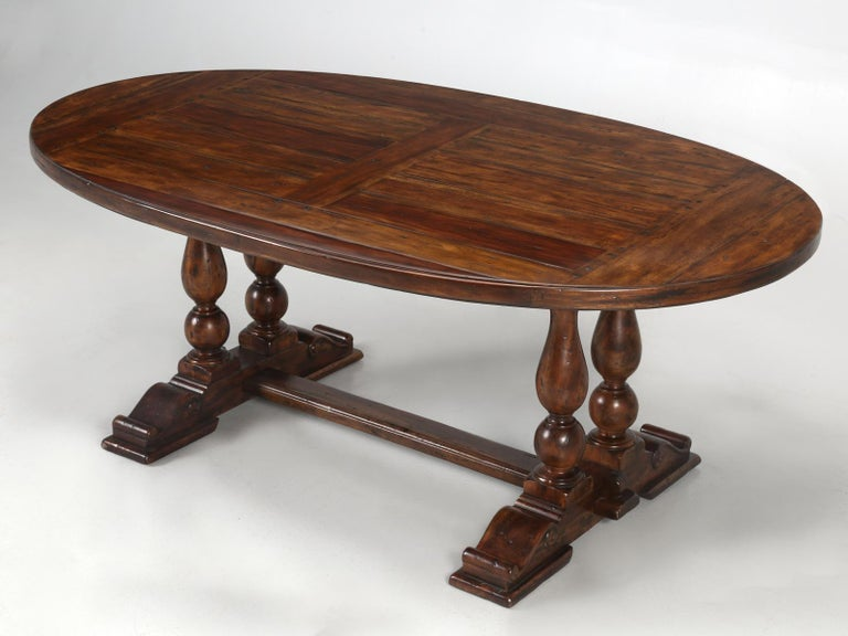 Reproduction oval farm house style dining table made from reclaimed hardwood. A great chunky rustic look for not much dough. Fantastic in a wine cellar.
