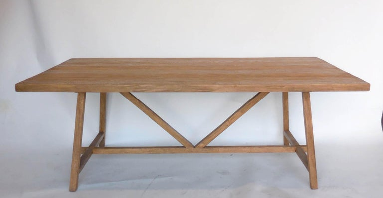 Made out of reclaimed 2 inch thick douglas fir, in Dos gallos Studio Light Latte finish. V stretcher, generous overhang for seating all around table. Made in Los Angeles by Dos Gallos Studio. Can be made in custom sizes. Sturdy new construction with