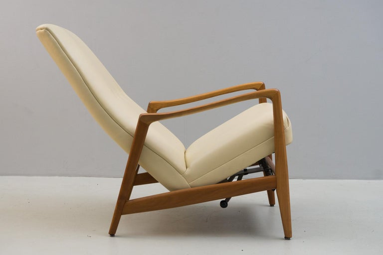This reclining elegant armchair with a high back was designed for Hotel Parco di Principi di Sorrento, considered one of the first design hotels. Made of walnut, the upholstery and cover was redone. Reclines continuously. Manufactured by Cassina