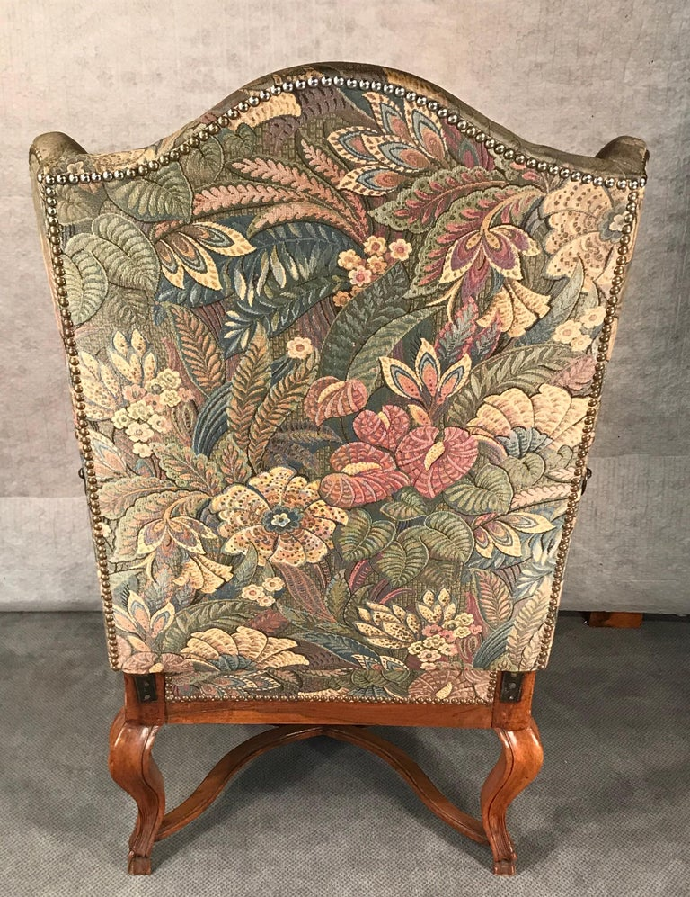 Reclining Baroque wingback chair, Southern Germany 1750-1760, walnut. This rare and interesting armchair is in original condition. The 18th century recline function is original. It has been reupholstered by a former owner. There is some fabric left