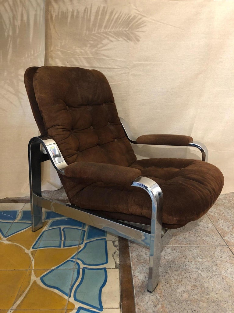 Comfortable armchair with chrome structure and suede upholstery from the 1970s matching ottoman.