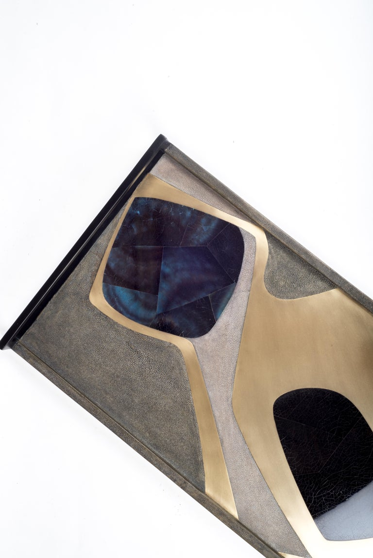 The Cosmos rectangle tray is a stunning tabletop piece for any space. Available in light or dark color way inlaid in a mixture of shagreen, pen shell and bronze-patina brass. Also available on a circular tray.  Measures: 24 x 13.5 x 2