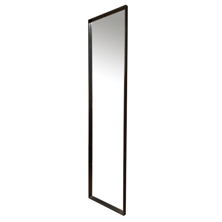 A WYETH original rectangular mirror with a machined deep-edge blackened bronze frame. Measures: 24 x 96 inches. Crafted by the Wyeth Workshop in NY. Available in polished, brushed, patinated or blackened bronze.  Also available in custom sizes.