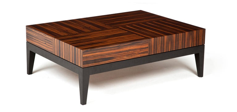 Statement rectangular coffee table with a bold and geometric Macassar ebony pattern and waterfall edge veneer detailing.  Stained walnut table base and legs. Finished with a hard-wearing polyurethane lacquer.