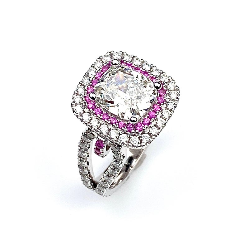 Double halo engagement ring with 1.70ct rectangular cushion cut center diamond H colour SI1 clarity, GIA #7272006151. Set with pink sapphire halo of 0.27ct total  and diamond-set outer halo, loop shank and petal pave' under-gallery, 1.27ct total.