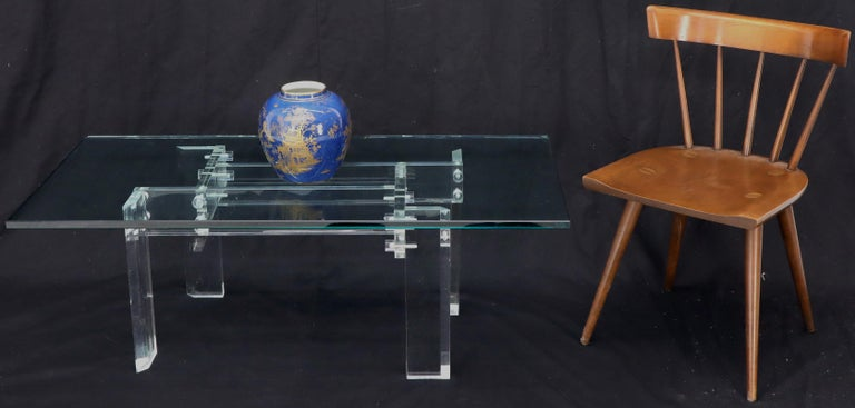 Mid-Century Modern thick glass top Lucite base coffee table.