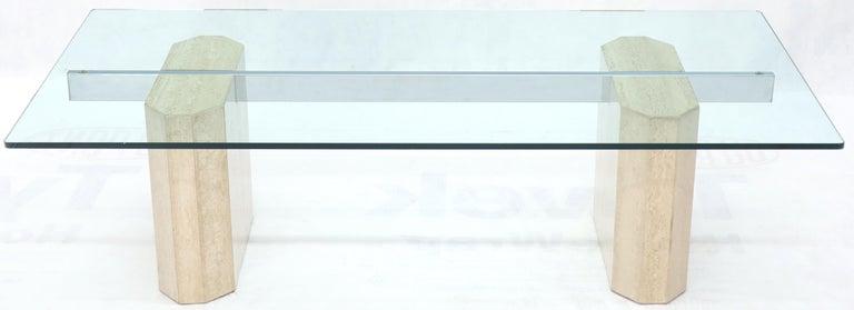 Mid-Century Modern rectangular glass top travertine base coffee table.