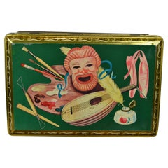 Rectangular Green Storage Tin with Mask, Ballet Shoes, Inkwell, Painting Pallet