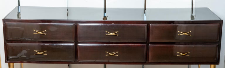 Rectangular lacquered wood and brass six drawer console with glass top.