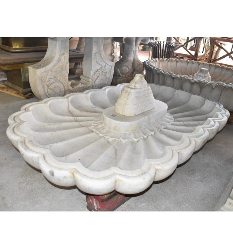 Rectangular marble hand-carved one piece floor fountain.