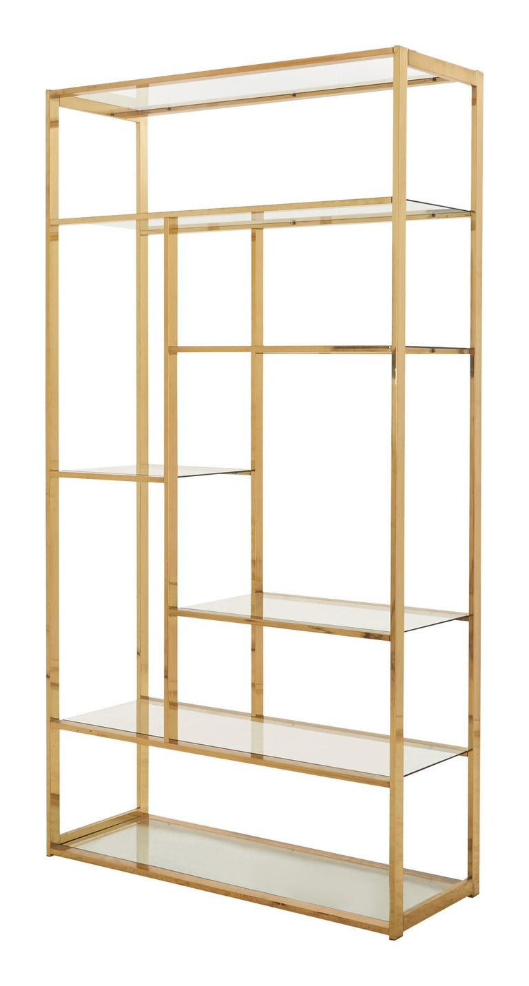 •In the style of Milo Baughman •Asymmetrical brass rectangular frame •Glass shelving •Mid-20th century •American •Measures: 42