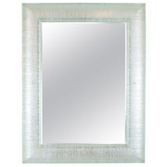 Rectangular Mirror Featuring Curved and Layered Glass Surround