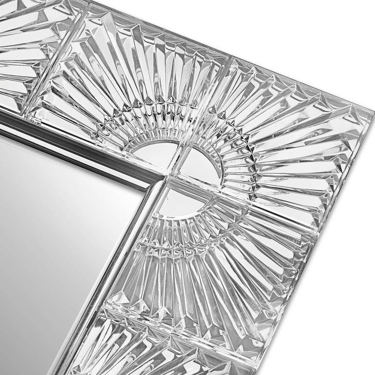 The ethereal elegance of crystal give this mirror a mesmerizing allure and makes it a timeless piece to adorn both a Classic and a modern home. The rectangular frame has a stainless steel structure that was entirely covered in 24% lead-crystal with