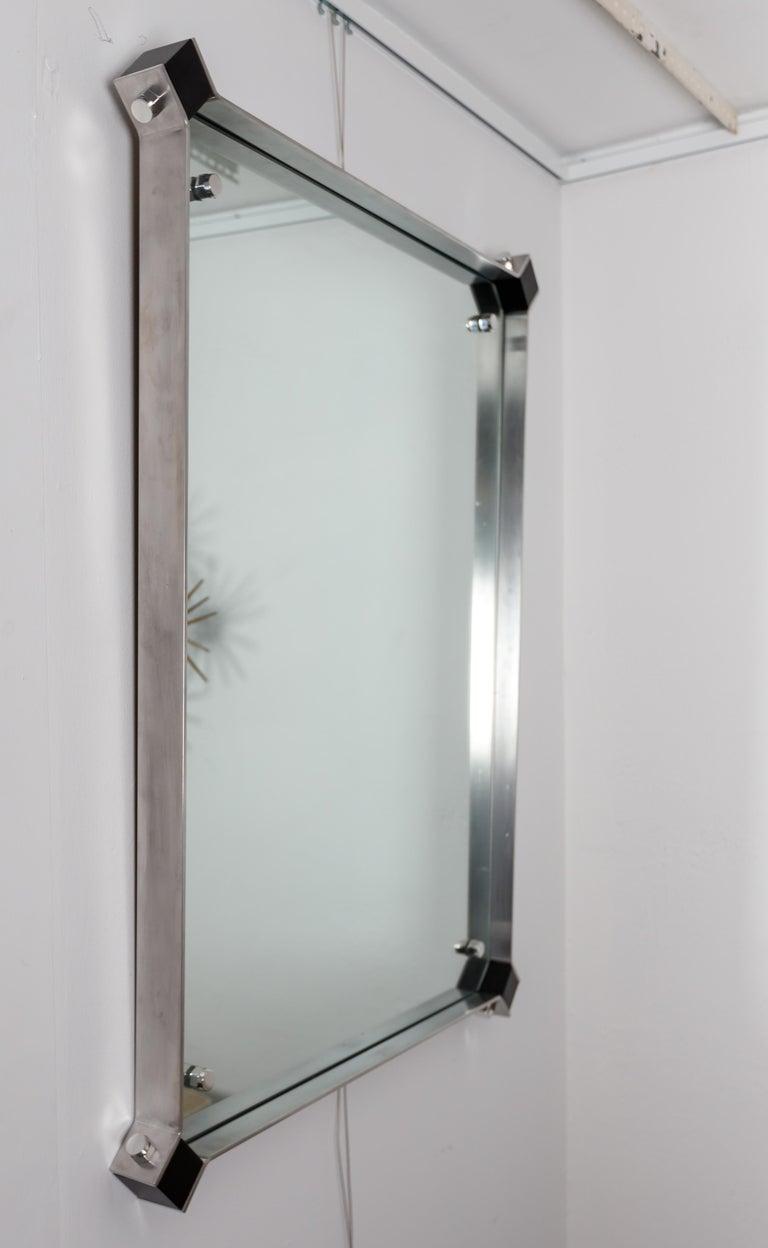 Mid-Century Modern Rectangular Mirror with Stainless Steel Surround with Black Corner Details For Sale