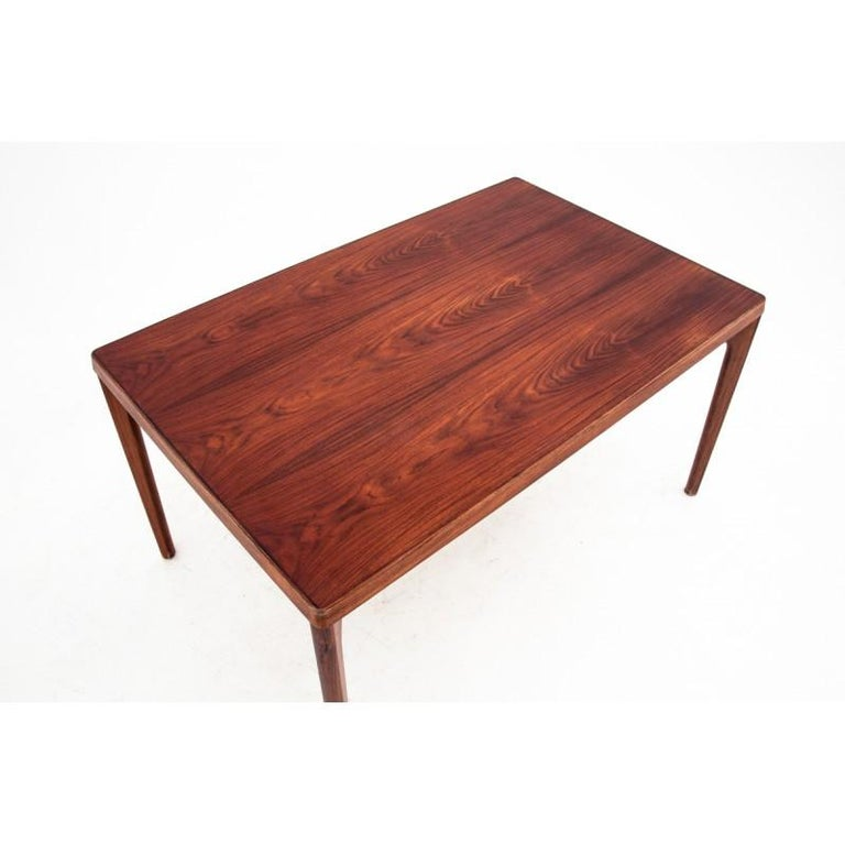 Rosewood rectangular table comes from Denmark in the 1960s. In excellent condition, after the wood renovation process. It has one additional inserts that allow it to unfold up to 220 cm.