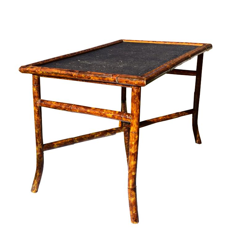 Tortoise shell or scorched bamboo coffee table. Beautiful rectangular coffee table with black woven cane or rattan top. Legs are splayed and are connected with a crossbar stretcher for added stability. At each end, an additional small piece of the
