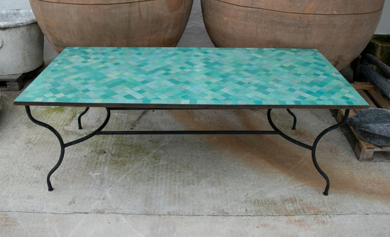 Contemporary Spanish green glazed Zellige tiled top rectangular outdoor table with iron base.
