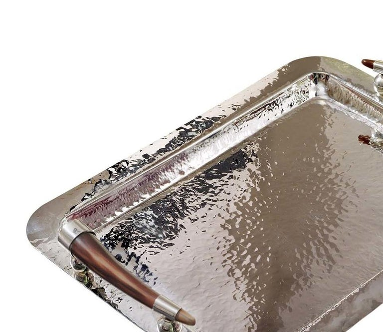 This sophisticated tray of the exclusive Horn collection by Petri Firenze is entirely handcrafted of silver plated brass. Showcased on a coffee table, bedroom dresser or bar cabinet, this tray is a refined choice for serving drinks or displaying