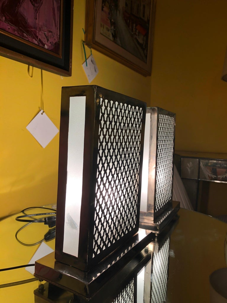 Featuring lean, rectangular dimensions, this authentically handcrafted table pair of lamps is fashioned from white brass and features amazing design details including hand-tooled Moorish style work. Compact and rustic, this is a beautiful addition