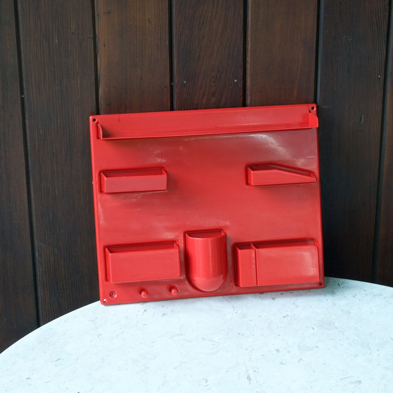 Interesting and well loved seventies pop-art survivor, relic. A wall mounting red plastic catch-all. Very old plastic wall art in your home or studio! Missing one key hook on left.