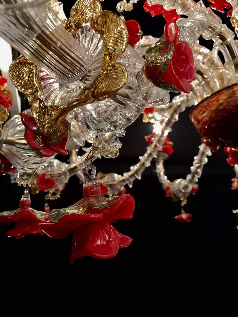Beautiful Murano chandelier with 24 arms and a multitude of flowers in glass paste and gold inclusion, creating a magic light effect. Available also a pair. 24 E14 light bulbs. We can wire for your country standards.