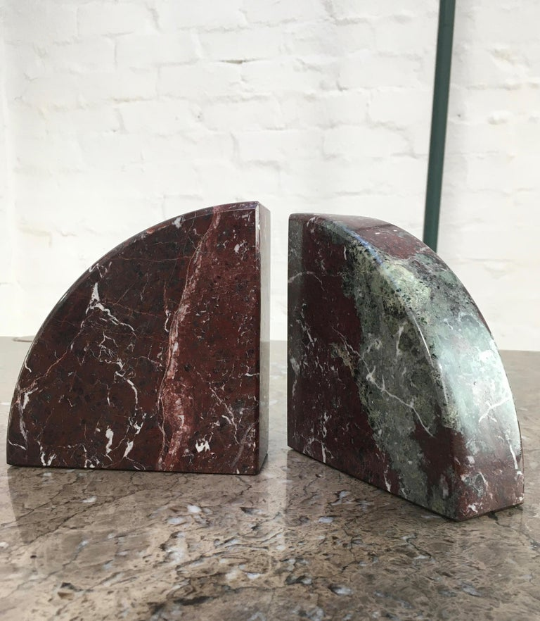 A pair of substantial bookends with great decorative appeal. These quadrant bookends can hold up a good heft of books but not too heavy to be easily handled and moved about to create the best decorative effect.