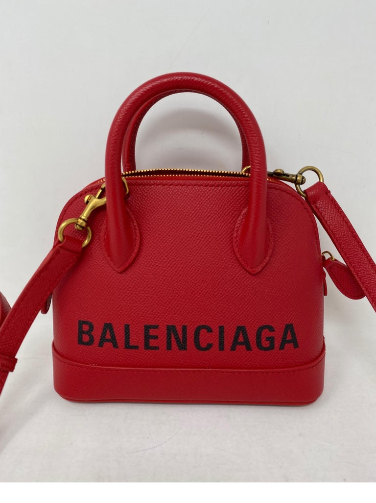 Red and Black Balenciaga Mini Bag. Crossbody or top handle mini bag. Mint like new condition. Very cute style bag. All leather. Includes dust cover. Guaranteed authentic.
