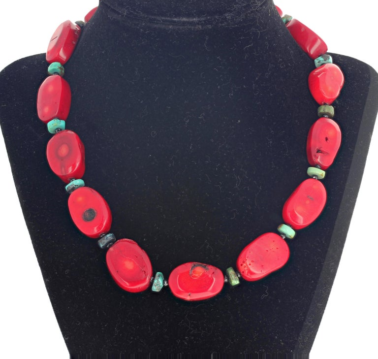Beautiful natural red Bamboo Coral accented with Blue/green natural Turquoise rondels and enhanced with sparkling gem cut black Spinel set in an elegant necklace with a sterling silver hook clasp.  More from this jeweler by putting Gemjunky into