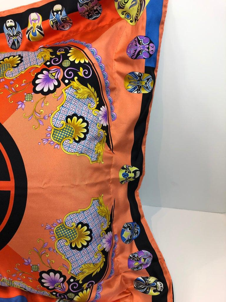 Offered is a late 20th century modern signed Gianni Versace silk scarf backed with black cotton percale and stuffed with a 28' x 28