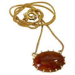 Red-Brown Jadeite Cabochon Pendant on Snake Chain in 18 Karat Yellow Gold