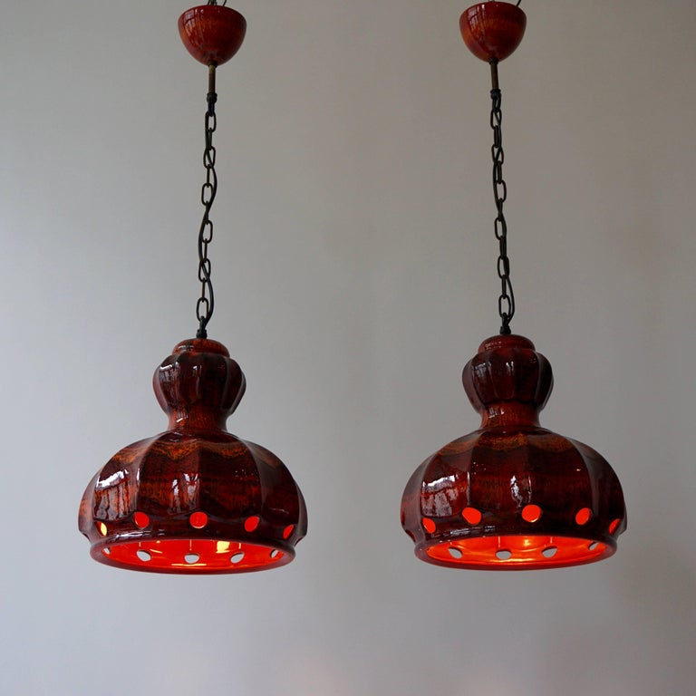 Two ceramic pendant lights.