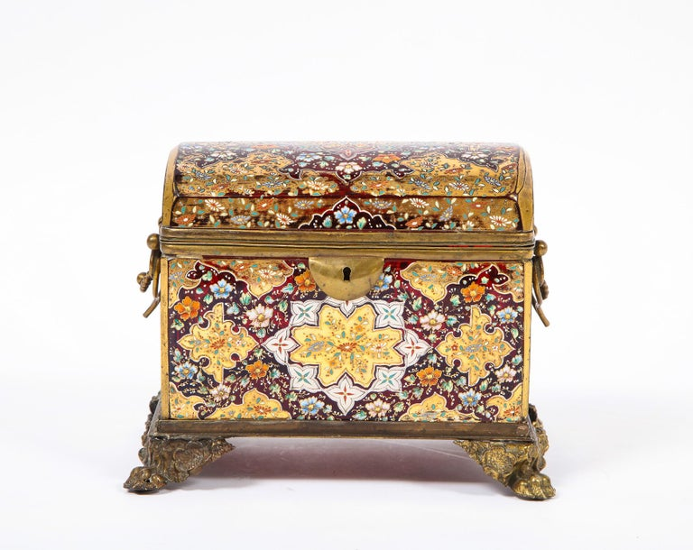 A beautiful red-cranberry Moser crystal and enameled box made for the Islamic/Moorish market. This box is made with beautifully handcut red-cranberry glass and overlayed with gorgeous platinum, 24-karat gold, white, yellow, green, orange, red, and