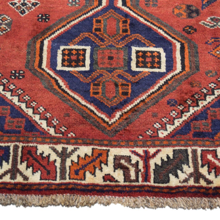 Tribal Red, Cream, and Indigo Traditional Persian Ghashghai Carpet For Sale