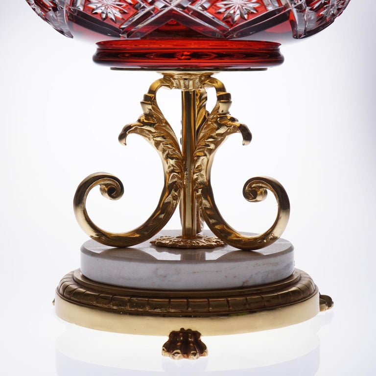 Beautiful red vase uniting crystal, marble and bronze covered with 22-carat gold  Impressive work on the 22-carat gold covered bronze.   High quality crystal handcrafted, a lot of beautiful details are cut in the red crystal.  The crystal is
