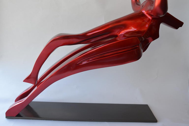 Enganar Rojo/Red Deceive is a large metal and fiberglass sculpture of a bull with a powder coating. By Mexican artist Mauricio Sorice.