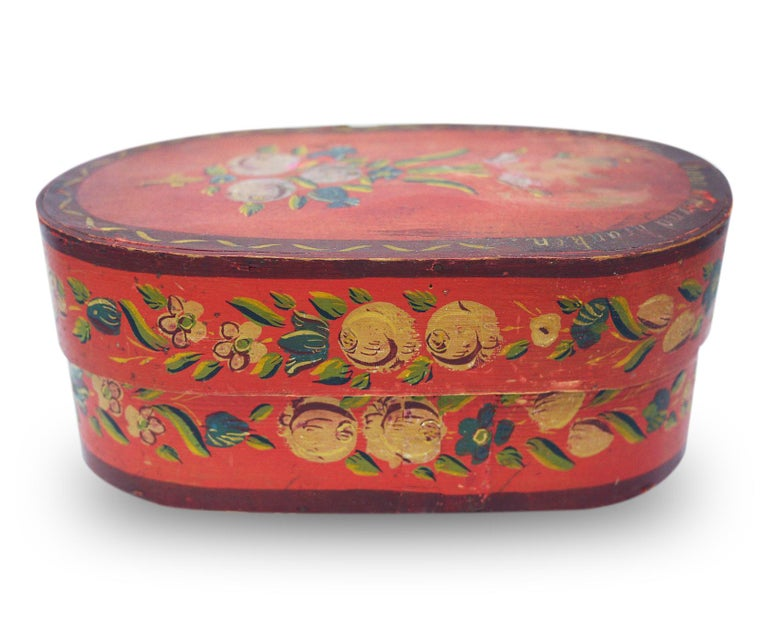 Alpine painted box  Measures: H 12cm, W 30cm, D. 18cm H. 4.7in, W. 11.8 in, D 7.1in  Fir-tree box painted in red. On the whole surface there are floral motifs. On the lid the phrase