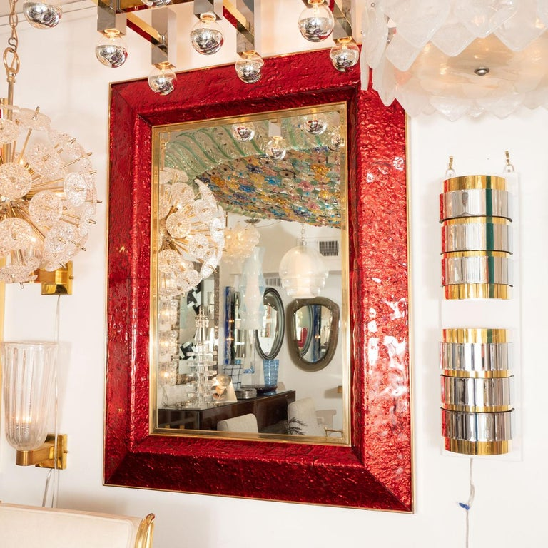 Rectangular brass and red glass surround mirror. Color can be customized.