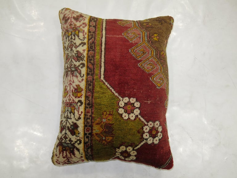 Pillow made from an antique Turkish rug from the early 20th century.  Measures: 15