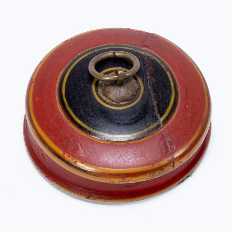 In many southeast Asian cultures, offering guests a betel quid to chew was the fundamental symbol of hospitality. A blend of leaves, nuts, seasonings, and sometimes tobacco, betel was kept in finely worked and decorated boxes. This round betel box